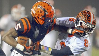 Clairton?s Terrish Webb pushes away Port Allegany?s Matt Bodamer as he carries in the PIAA semifinal Friday night.