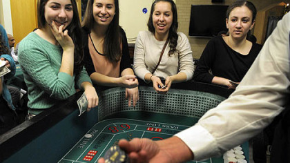 From left, Rachael Fleisig, Jenna Goldstein, Rayna Levine and Rebecca Kastrenakes, all 18-year-old students at the University of Pittsburgh, shoot craps at the Hillel Jewish University Center in Oakland at a Hanukkah event Thursday. Proceeds helped victims of Hurricane Sandy.