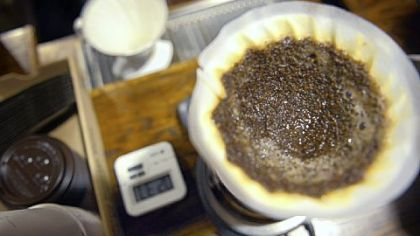 A cup of coffee brews by the pour-over method at 21st Street Coffee and Tea in the Strip District.