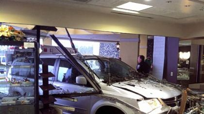 A driver lost control of a handicapped-accessible van Saturday afternoon and drove into the Casa D'Oro jewelry store located in the Four Points by Sheraton hotel in Marshall.