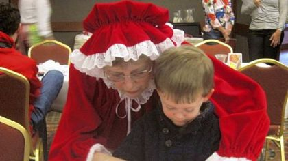 Mrs. Claus helps a little one decorate cupcakes at the Osthoff Resort in Elkhart Lake, Wis., 60 miles north of Milwaukee.