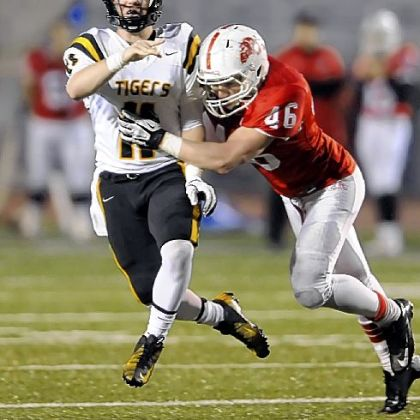 North Allegheny quarterback Mack Leftwich gets a pass off before getting hit by Wilson's Dominic Moyer.