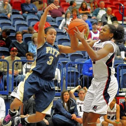 Pitt's Brianna Kiesel, left, fights for the ball along the baseline with Duquesne's Jose-Ann Johnson in the first half Saturday at the Palumbo Center.