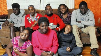 The Reese family at home, from left, front row: Taylor, 8; Clarisa, 18; Zachary, 7. On couch, from left: Henderson, 14; Joyce and Melanee; Cori, 14; and Donald, 16. Zachary and Cori are Joyce's grandchildren. Not pictured are Christopher and Jessica.