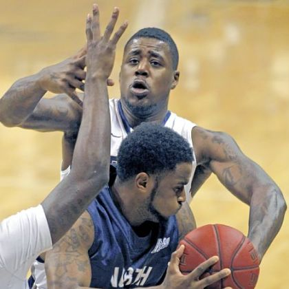 Dante Taylor defends North Florida's Travis Wallace in the second half of Pitt's 89-47 win Saturday night.