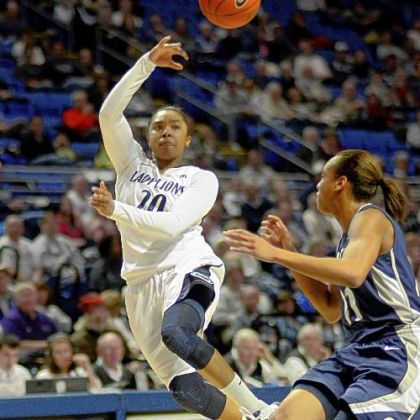 Penn State's Alex Bentley passes across the paint past Georgetown's Andrea White in the Nittany Lions' home victory.