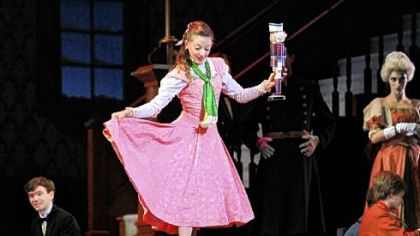 "Alexandra Kochis as ""Marie"" dances with the nutcracker in the Party scene during a rehearsal of the holiday classic ""The Nutcracker,"" presented by Pittsburgh Ballet Theatre at the Benedum Center."