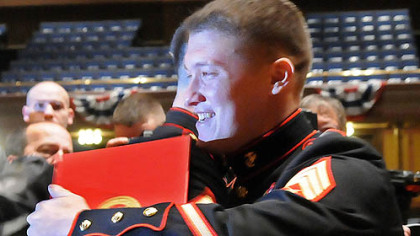 Marine Sgt. David M. Gerardi (right) gets congratulations from fellow Marines after receiving the Silver Star Medal for valor for action in Afghanistan.