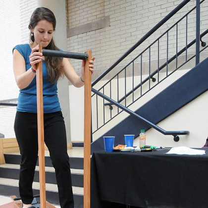 Carnegie Mellon University senior Kyra Gould demonstrates her team's human-powered shallow well pump that uses a design based on a cross-country ski exercise device.