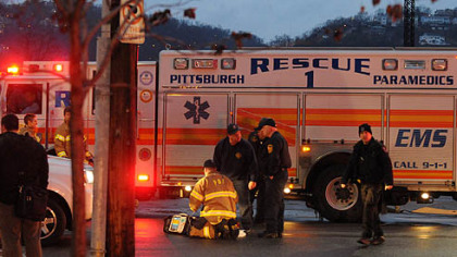Emergency workers at the intersection of 14th Street and Smallman Street in Pittsburgh's Strip District where a pedestrian was fatally injured.