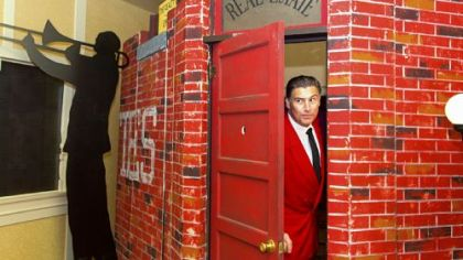 Speakeasy Gangster Howard Mincone asks for the password at the faux door to Speakeasy during its opening on Wednesday.