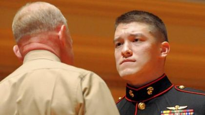 Maj. Gen. Melvin G. Spiese, left, congratulates Marine Sgt. David M. Gerardi after awarding him the Silver Star Medal for valor for action in Afghanistan during ceremonies at the Soldiers & Sailors Hall and Museum on Monday.