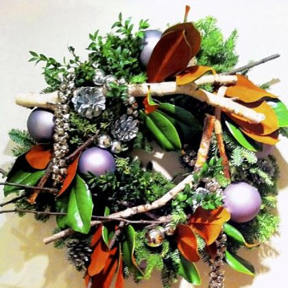Hens and Chicks blends contemporary with traditional in this wreath.