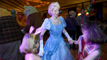 Katherine Bodner, of Jefferson Hills,  Cinderella for the night, dances with children at the Reindeer Ball.