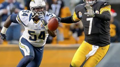 Steelers quarterback Ben Roethlisberger gets pressured by Chargers linebacker Melvin Ingram in Sunday's 34-24 loss.