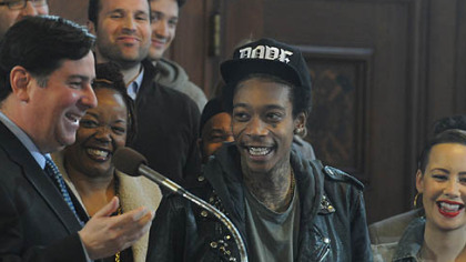 Pittsburgh City Councilman Bill Peduto laughs with Wiz Khalifa and his family, after reading the  proclamation that Dec. 12, 2012, will be Wiz Khalifa Day.