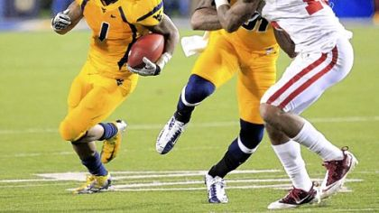 West Virginia's Tavon Austin's huge game against Oklahoma is a big reason for his selection to the Associated Press All-America first team.
