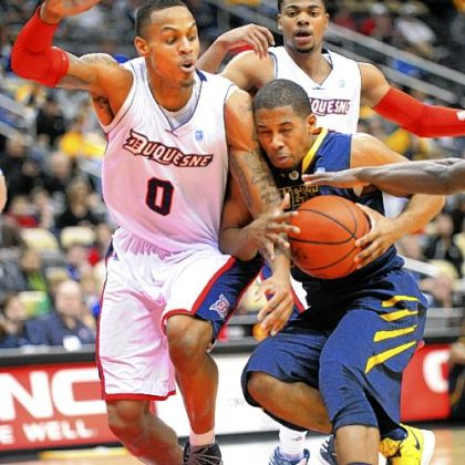 Duquesne Andre Marhold, left, cuts off West Virginia's Gary Browne in first half Tuesday night.