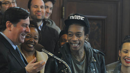 Councilman Bill Peduto laughs  with Wiz Khalifa after reading the  proclamation  in council's chambers.