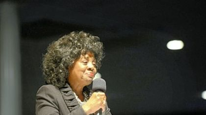 "Newly inducted NAACP president Constance ""Connie"" Parker  addresses a crowd Tuesday night."