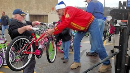 Bill Ringler, left, and Andy Burch, both of Tarentum, load some of the 300 bicycles donated by Al's Bike Drive to the Marine Corps Toys for Tots program on Tuesday. The men are members of the Allegheny Valley Detachment 827 of the Marine Corps League.