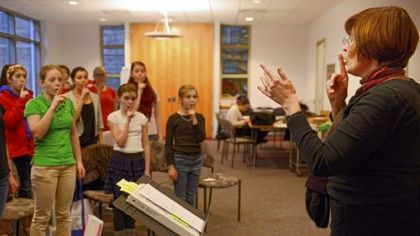 Kathryn Barnard conducts the Oakland Girls Choir in a rehearsal at the Church of the Ascension.