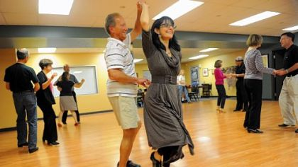 Luanne O'Brien, founder of Integral Ballroom Dance, warms up with Dennis Bradley of Murrysville.