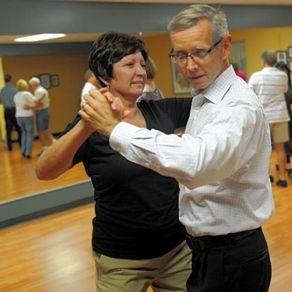 Sharon Wise, left, of Greensburg dances with Joe O'Brien in a class at Integral Ballroom Dance.