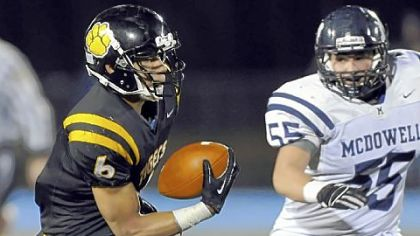 North Allegheny junior Elijah Zeise looks for running room after catching a pass in a PIAA quarterfinal victory in front of McDowell's Joel Mascharka.