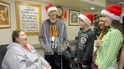 "Mark Kunkel, Luke English, Gracie Hamalaine and Olivia English, all 12 years old and in the seventh grade, are part of 45 Seneca Valley Middle School ""Tiger Team"" members visiting residents at Passavant Retirement Center in Zelienople."