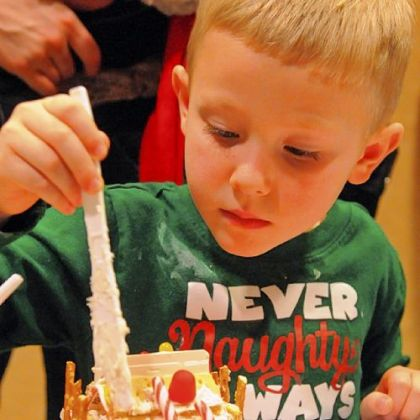 Jory Tumbleson, 4, applies a mortar of tasty icing to his gingerbread house.