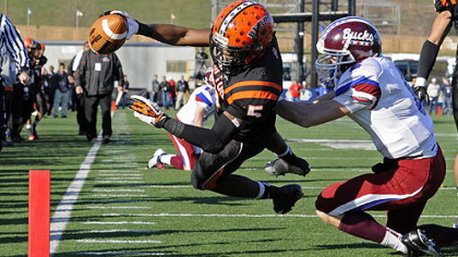 Clairton's Terrish Webb dives into the end zone for a touchdown against Dunmore's John Rinaldi in the PIAA class A championship at Hersheypark Stadium Friday.