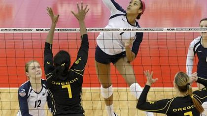 Penn State&#039;s Nia Grant, center, goes for a kill over the defense of Oregon&#039;s Ariana Williams Thursday in Louisville, Ky.