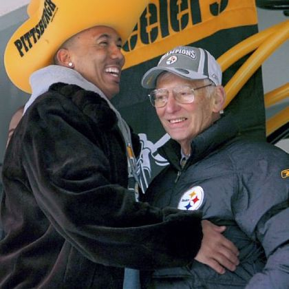 Steelers Hines Ward greets team owner Dan Rooney on the stage during a parade for the Super Bowl XL champion Pittsburgh Steelers.