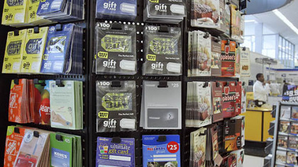 Gift cards for various retailers are offered for sale at a supermarket in Omaha, Neb.