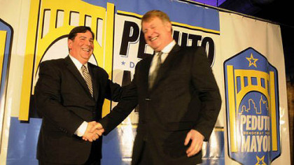 Pittsburgh Councilman Bill Peduto, left, as he announces his run for mayor, greets Allegheny County Executive Rich Fitzgerald at the Crucible Building in the Strip District on Thursday.