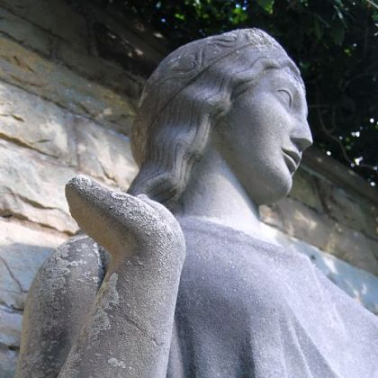 This limestone Dryad statue, which is missing a hand, was designed and sculpted in 1918 by Paul Manship.