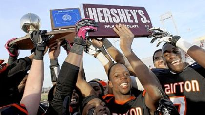 The Clairton Bears hoist the title trophy as they celebrate their fourth consecutive PIAA championship and extend Pennsylvania record to 63 wins in a row Friday at HersheyPark Stadium.