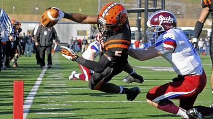 Clairton&#039;s Terrish Webb dives into the end zone for a touchdown against Dunmore&#039;s John Rinaldi in the PIAA Class A championship Friday at Hersheypark Stadium in Hershey, Pa.
