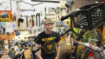 Nicholas Brungo, owner of Love Bikes, at his shop in an alleyway behind Arsenal Lanes in Lawrenceville, recently wrapped up a campaign to raise funds to start a new venture -- building bikes out of bamboo.