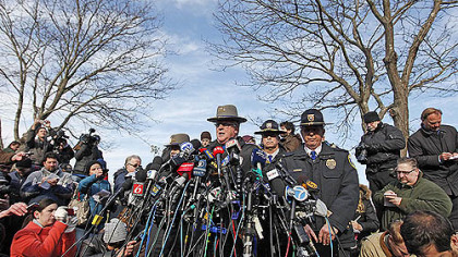 Lt. J. Paul Vance of the Connecticut State Police conducts a news briefing, this morning in Newtown, Conn. updating progress in the investigation of yesterday's massacre at the Sandy Hook Elementary School.