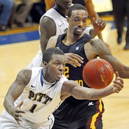 Tray Woodall beats Bethune-Cookman's Alex Smith to a loose ball in the second half Saturday night at Petersen Events Center. Pitt rolled to an 89-40 victory.