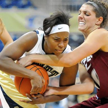 Pitt's Ashlee Anderson (left) battles Rider's Emily Fazzini for a loose ball in the first half of women's basketball game Sunday at the Peterson Events Center. Rider won, 65-48.
