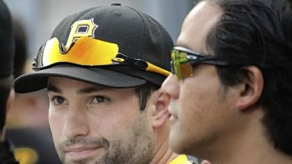 Neil Walker gets a pat on the back from physical therapist Erwin Valencia at an Aug. 16 game against the Dodgers.