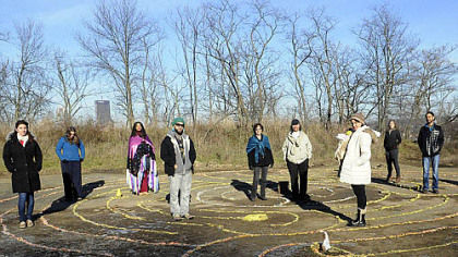 Vikki Hanchin from Swissvale and Miguel Sague from Penn Hills stand at the center of the Mayan labyrinth in Bandhi Schaum Park on the South Side Slopes. They are joined by other Mayan calendar devotees who oppose the doomsday scenarios that predict the end of the world.