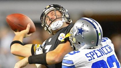 Steelers quarterback Ben Roethlisberger is sacked by the Cowboys' Anthony Spencer.