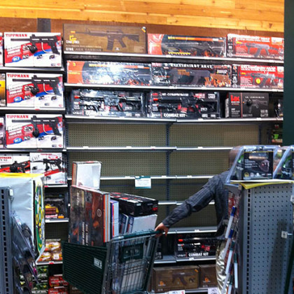 An employee at Dick's Sporting Goods in South Hills Village clears shelves Tuesday of Airsoft guns that resemble the AR-15.