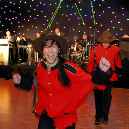 Mountie dancers entertain at the Epilepsy Foundation Mardi Gras