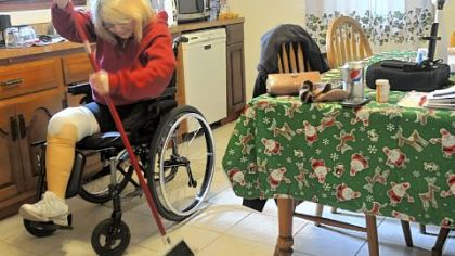 "Catherine Fielding, a double amputee, sweeps the floors  in her Richland home. ""I do my own cooking, my own laundry, my own dishes,"" she says."