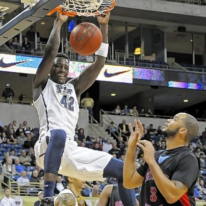 Pitt&#039;s Talib Zanna dunks for two of his game-high 20 points in the Panthers&#039; rout of Delaware State Wednesday at Petersen Events Center.